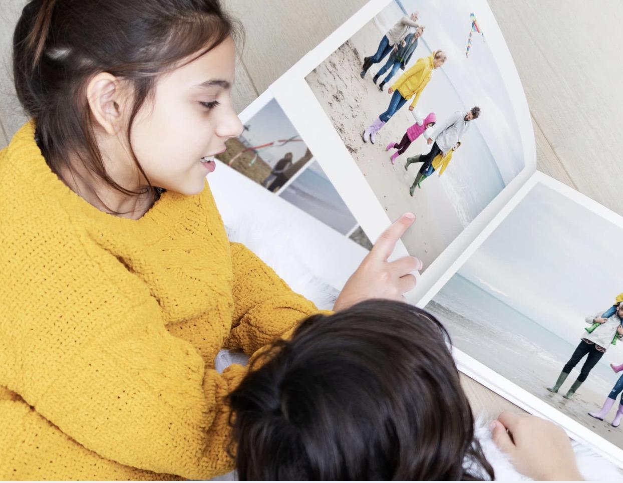 Code promo PhotoBox : Les pages en plus offertes en illimité sur les livres photos